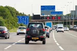 DVSA drivers survey. Car driving down a UK motorway in the middle lane