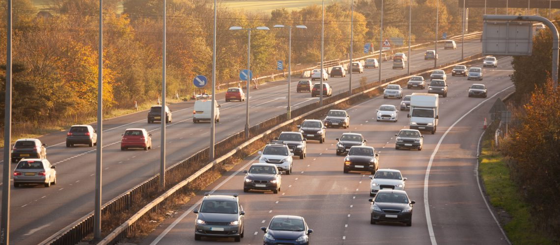 winter sun on sunday motorway traffic Essex England